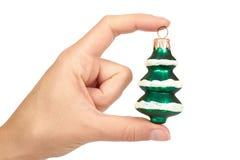 Decoración de Cristmas, árbol verde de cerámica a disposición aislado en el fondo blanco Objeto del Año Nuevo Fotografía de archivo