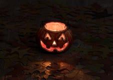 Decoración de la calabaza que brilla intensamente en fondo oscuro imagenes de archivo