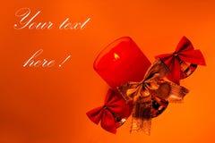 Decoración de la cinta de la Navidad con la vela Fotografía de archivo
