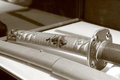 Decoración de la espada del samurai Sepia Imagenes de archivo
