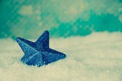 Decoración de la estrella de la Feliz Navidad Fotos de archivo libres de regalías
