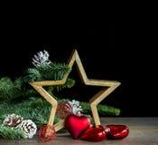 Decoración de la Navidad con la estrella de madera Foto de archivo libre de regalías