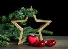 Decoración de la Navidad con la estrella de madera Fotos de archivo libres de regalías