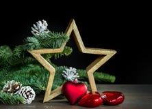 Decoración de la Navidad con la estrella de madera Fotografía de archivo libre de regalías