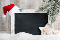 Decoración de la Navidad con la pizarra en blanco Fotografía de archivo