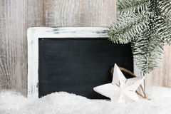 Decoración de la Navidad con la pizarra en blanco Foto de archivo libre de regalías