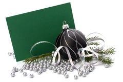 Decoración de la Navidad con la tarjeta de felicitación Fotografía de archivo libre de regalías