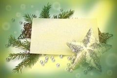 Decoración de la Navidad con la tarjeta de felicitación Foto de archivo