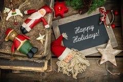 Decoración de la Navidad con las chucherías y los juguetes del vintage Fotos de archivo