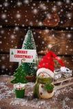 Decoración de la Navidad con nieve en fondo de madera Imágenes de archivo libres de regalías
