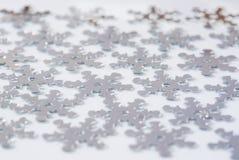 Decoración de la Navidad de la escama de plata de la nieve del confeti Foto de archivo