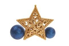 Decoración de la Navidad de la estrella y de la chuchería del oro Foto de archivo libre de regalías