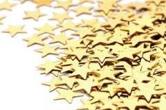 Decoración de la Navidad de las estrellas de oro del confeti contra Imagen de archivo libre de regalías