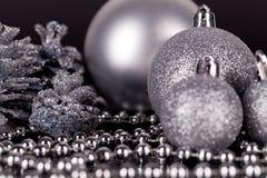 Decoración de la Navidad en plata en negro Foto de archivo libre de regalías