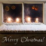 Decoración de la Navidad en una ventana Imagenes de archivo