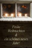 Decoración de la Navidad en una ventana Fotografía de archivo