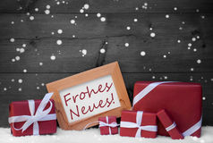 Decoración de la Navidad, regalos, nieve, escamas, Frohes Neues, Año Nuevo Fotografía de archivo