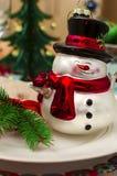 Decoración de la Navidad y del Año Nuevo con el muñeco de nieve Fotos de archivo libres de regalías