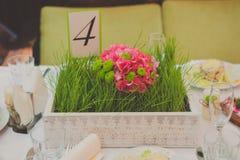 Decoración de la tabla con números de la tabla de las flores Fotografía de archivo