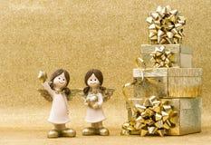 Decoración de los días de fiesta La Navidad Ángeles de la caja de regalo Imagen de archivo libre de regalías