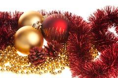Decoración de oro y roja de la Navidad Fotografía de archivo