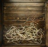 Decoración de papel de la paja en un tablero de madera Fotografía de archivo libre de regalías