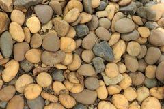Decoración de piedra en un piso Fotos de archivo