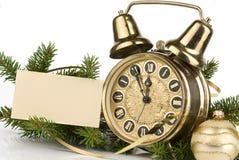 Decoración del Año Nuevo con un reloj antiguo Fotos de archivo