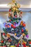 Decoración del oro de la campana del árbol de navidad Foto de archivo