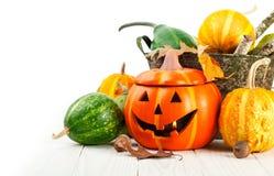 Decoración del otoño de Halloween del día de fiesta con las calabazas de la Jack-o-linterna Fotos de archivo