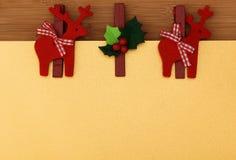 Decoración del reno de la Navidad en el oro fotografía de archivo libre de regalías