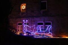 Decoración del reno y de la Navidad del trineo imagenes de archivo