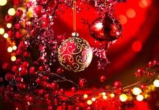 Decoración del rojo de la Navidad y del Año Nuevo Fondo del día de fiesta del centelleo Foto de archivo