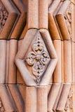 Decoración en la entrada a la abadía de Jedburgh en el Bor escocés Fotos de archivo libres de regalías