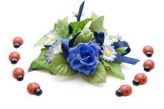 Decoración floral azul con el ladybug Foto de archivo libre de regalías