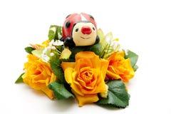 Decoración floral con el ladybug Fotos de archivo libres de regalías
