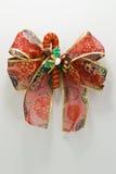 Decoración roja de la cinta de la Navidad fotografía de archivo libre de regalías