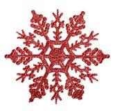 Decoración roja de la forma del copo de nieve isolted en blanco Imagen de archivo