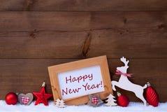 Decoración roja de la Navidad, Feliz Año Nuevo, nieve Fotos de archivo libres de regalías