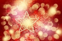 Decoración roja del brillo con la estrella de oro grande Imagen de archivo libre de regalías