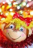 Decoración sonriente de la Navidad del mono Foto de archivo libre de regalías