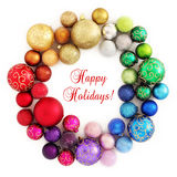 Decoración de la guirnalda del arco iris de la Navidad en blanco Foto de archivo