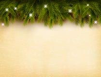 Decoración de la Navidad en viejo fondo de papel Imagen de archivo