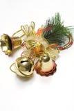 Decoraciones de la alarma de la Navidad con los fondos blancos imagen de archivo libre de regalías