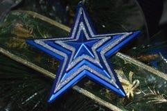 Decoraciones de la estrella de la Navidad imagenes de archivo