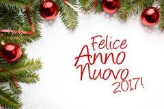 ¡Decoraciones de la Navidad con el saludo del Año Nuevo en el ` italiano Felice Anno Nuovo 2017! ` Imagenes de archivo