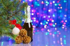 Decoraciones de la Navidad con la picea y el champán Imagen de archivo