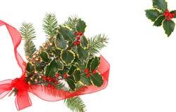 Decoraciones de la Navidad con las bayas del acebo Imagen de archivo libre de regalías