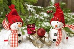 Decoraciones de la Navidad con los muñecos de nieve Foto de archivo libre de regalías