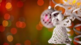 Decoraciones de la Navidad contra luces borrosas de Navidad del centelleo metrajes